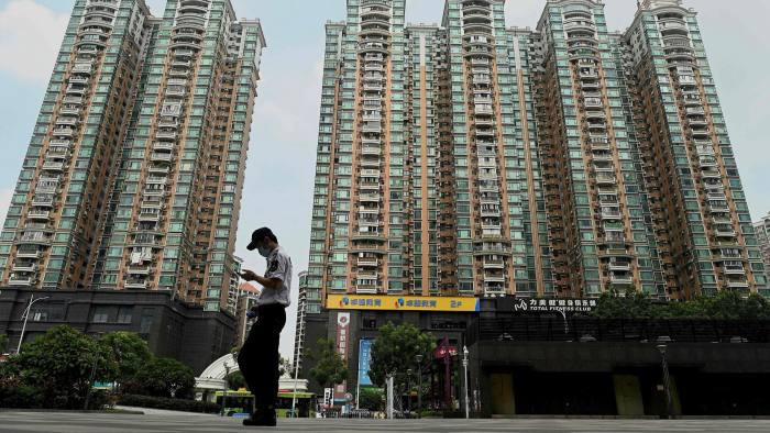 Fitch Ratings hạ dự báo tăng trưởng của Trung Quốc - Ảnh 1.