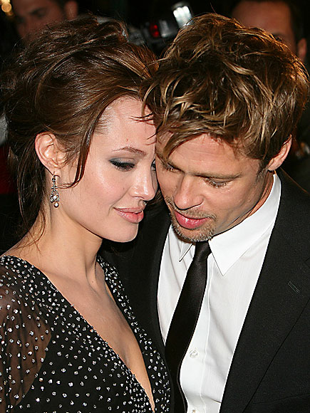 Seven months after the birth of daughter Shiloh, Brad Pitt and Angelina Jolie share a tender moment on the red carpet during a parents-only date night at the New York City premiere of The Good Shepherd on Dec. 11, 2006.