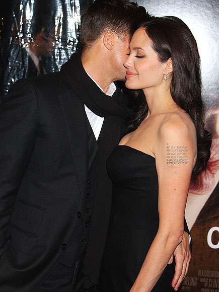 A beaming Jolie happily accepts her mans congratulatory squeeze at an October 2008 New York Film Festival screening of The Changeling, which would later earn her an Oscar nod.