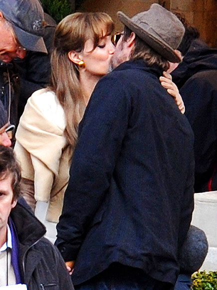 Its not all work on the set of The Tourist! During a break in shooting in February 2010, Jolie leaves Johnny Depps  side to sneak a smooch with her real-life leading man. We tell the  kids, Mom and Dad are going off to kiss. They go, Eww, gross! Pitt  said of how he and his future missus squeeze in alone time.
