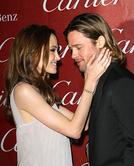 As Pitt celebrates another Moneyball accolade, Jolie offers her  fiancé her own congratulations on Jan. 7, 2012, while accompanying him  to the Palm Springs International Film Festival.