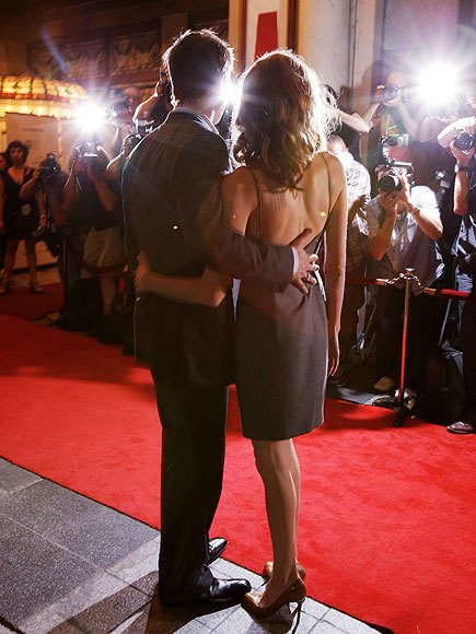 Proving theyve got each others backs, the couple sticks close together while premiering Pitts film, The Assassination of Jesse James by the Coward Robert Ford, at the Toronto International Film Festival in September 2007.