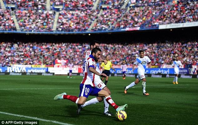 Turan ấn định thắng lợi cho chủ nhà Atletico.