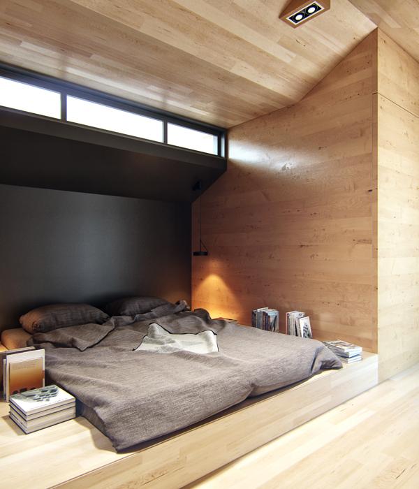 Phòng ngủ đơn giản với giường bệt và đèn ngủ nhỏ gọn.