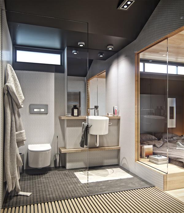 Phòng tắm mang tông màu ghi - trắng, có cửa kính trong suốt tạo cảm giác rộng rãi.
