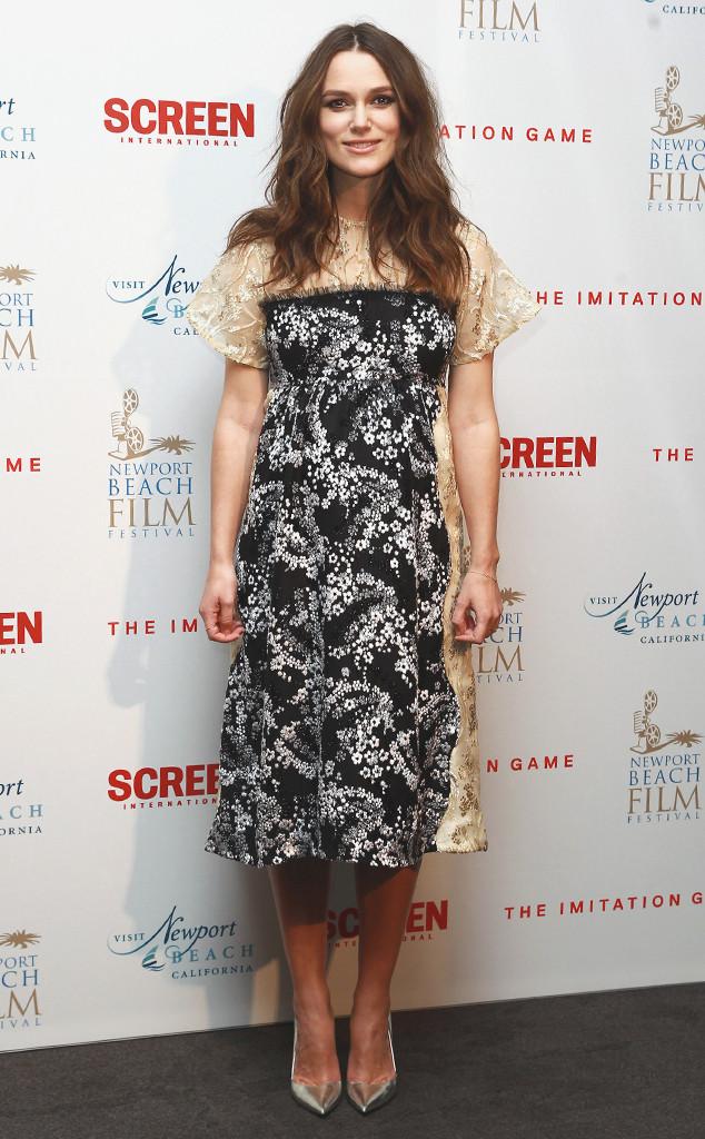 Người đẹp vừa lôi cuốn vừa không bị lộ bụng bầu quá nhiều trong bộ váy floral tuyệt đẹp ở buổi công chiếu phim The Imitation Game tại London (Anh).
