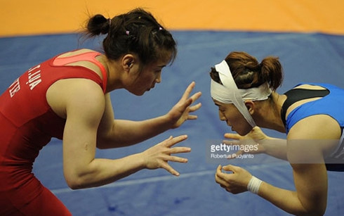 Đô vật Nguyễn Thị Lụa (áo đỏ) không khó khăn để giành vé Olympic. (Ảnh: GT)
