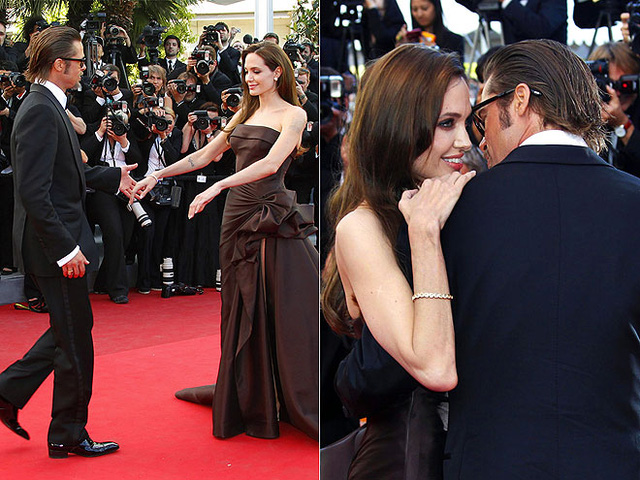 WALK THIS WAY  Jolie  waits patiently for Pitt to escort her down the red carpet, before  holding onto him yet again, at the May 2011 Cannes Film Festival debut  of The Tree of Life.