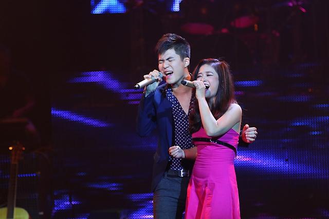 Ca sĩ Tiến Mạnh và Dương Hoàng Yến trình bày ca khúc Ngày lặng gió của tác giả Hải Thuận.