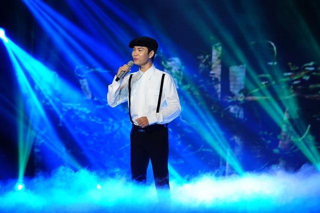 Quang Đại vẫn ngọt ngào, da diết như các vòng thi trước với ca khúc Cô hàng xóm