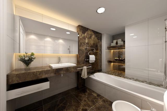 Đá hoa cương màu tối làm nổi bật những gam màu trắng được sử dụng trong nội thất phòng tắm