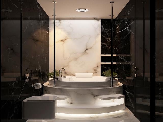 Đá hoa cương màu đen bóng làm tôn lên vẻ đẹp mạnh mẽ của căn phòng tắm này