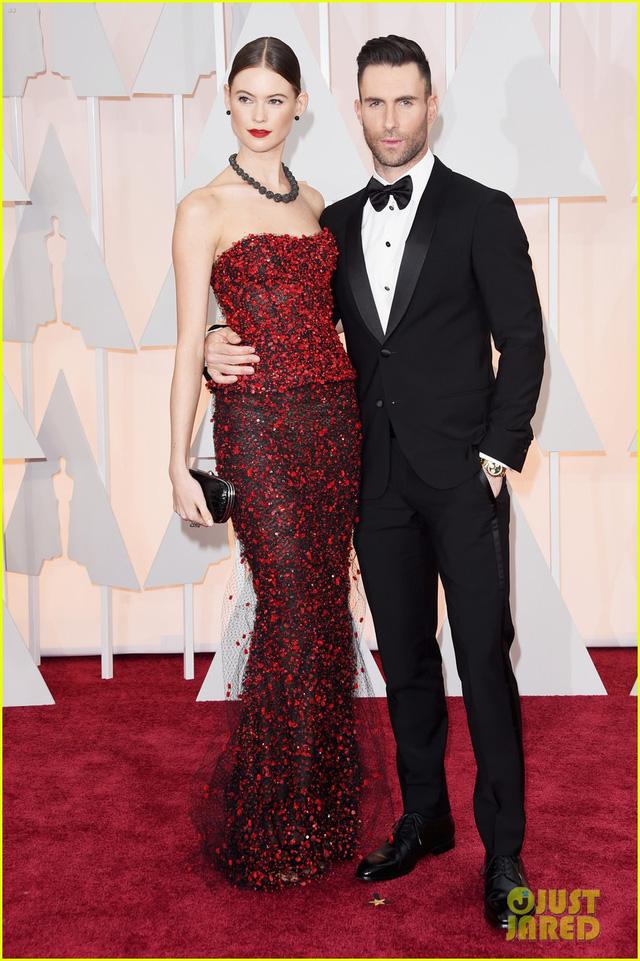 Đôi vợ chồng nổi tiếng nhanh chóng thu hút mọi sự chú ý ngay khi xuất hiện trên thảm đỏ lễ trao giải Oscar 2015