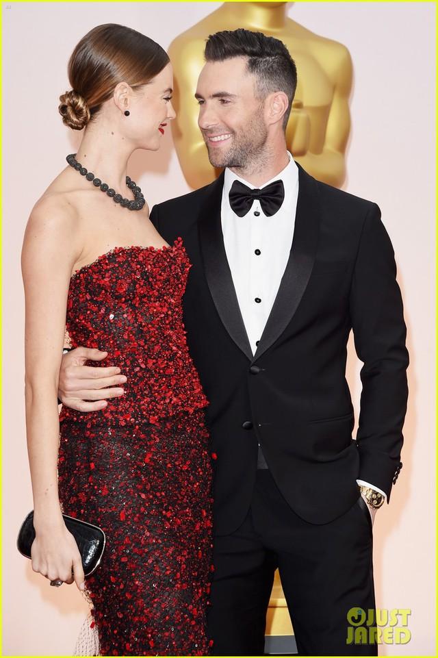 Adam Levine và Behati Prinsloo được đánh giá là một trong những cặp đôi nổi bật nhất trong lễ trao giải Oscar lần thứ 87 diễn ra tại nhà hát Dolby, Los Angeles