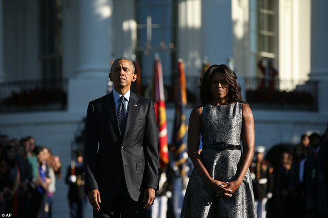 President Barack Obama and first lady Michelle Obama pause on the South Lawn of the White House in Washington, DC on Friday, September 11, 2015, as they observed a moment of silence to mark the 14th anniversary of the 9/11 attacks