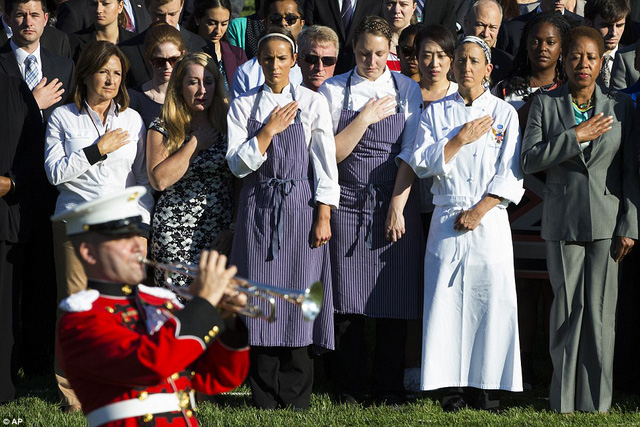 White House staff listen as a bugler plays Taps during a ceremony on the South Lawn of the White House in Washington, DC on Friday, September 11, 2015, with President Barack Obama and first lady Michelle Obama to observe the 14th anniversary of the 9/11 terrorist attacks