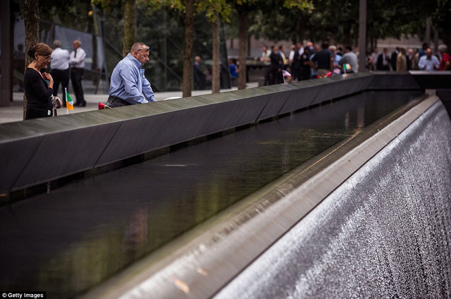 A man stands in a moment of silence at the 9-11 Memorial site on September 11, 2015 in New York City