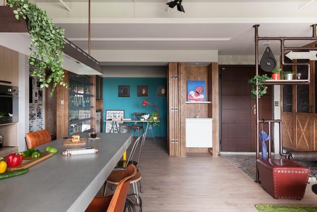 Chủ nhân căn hộ có thể giấu phòng làm việc bằng vách ngăn khi không có nhu cầu sử dụng