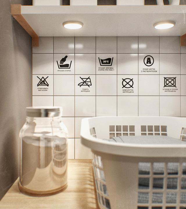 Bức tường trắng được dán thêm những hình ảnh sinh động, phù hợp với nơi giặt đồ.