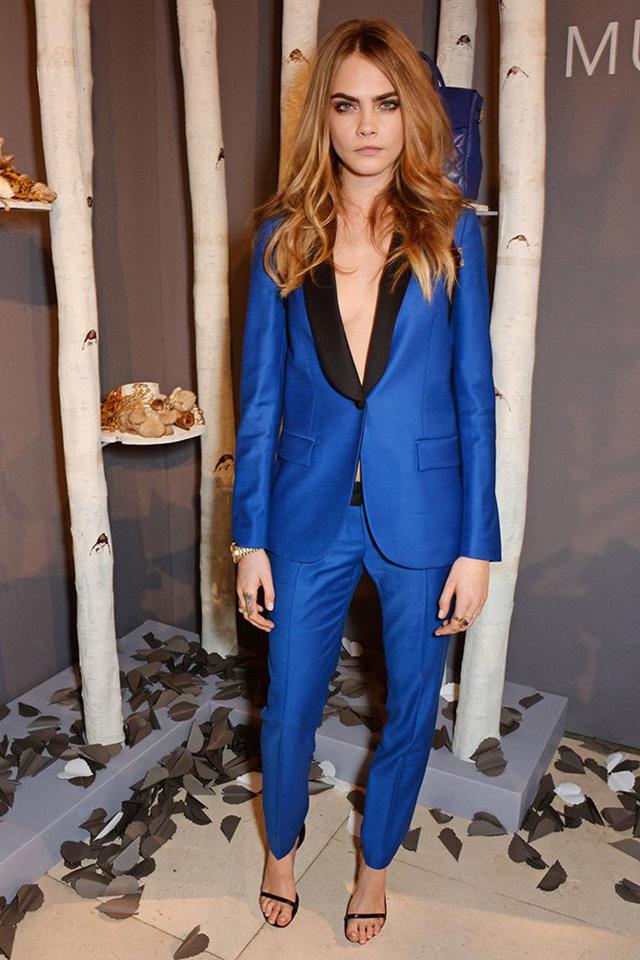"""Không chỉ được mệnh danh là Nữ hoàng catwalk thế giới, Cara Delevingne còn nổi tiếng bởi style thời trang phá cách và được gọi là nàng """"tomboy"""" xinh đẹp của giới siêu mẫu."""