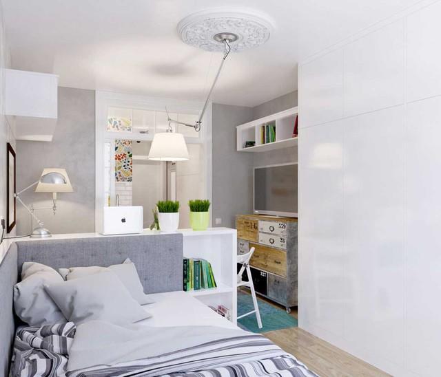 Giá để đồ được tận dụng để làm thành vách ngăn cho không gian tiếp khách, ăn uống với không gian ngủ, nghỉ ngơi.