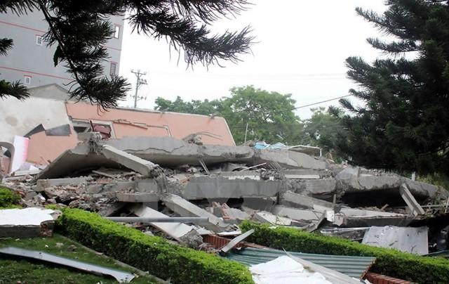 Hiện trường nơi căn nhà đổ sập. (Ảnh: TTXVN)
