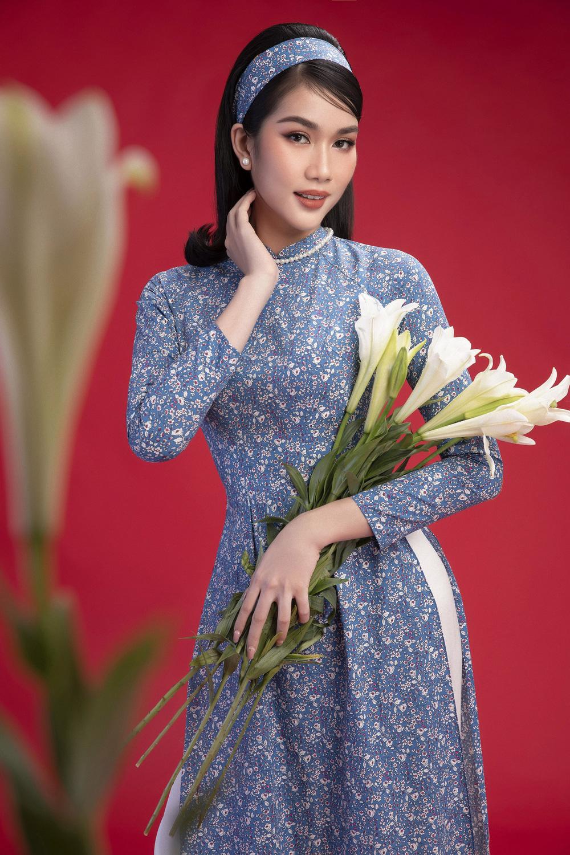 Hoa hậu Đỗ Thị Hà khoe vẻ sắc sảo với áo dài retro - ảnh 10