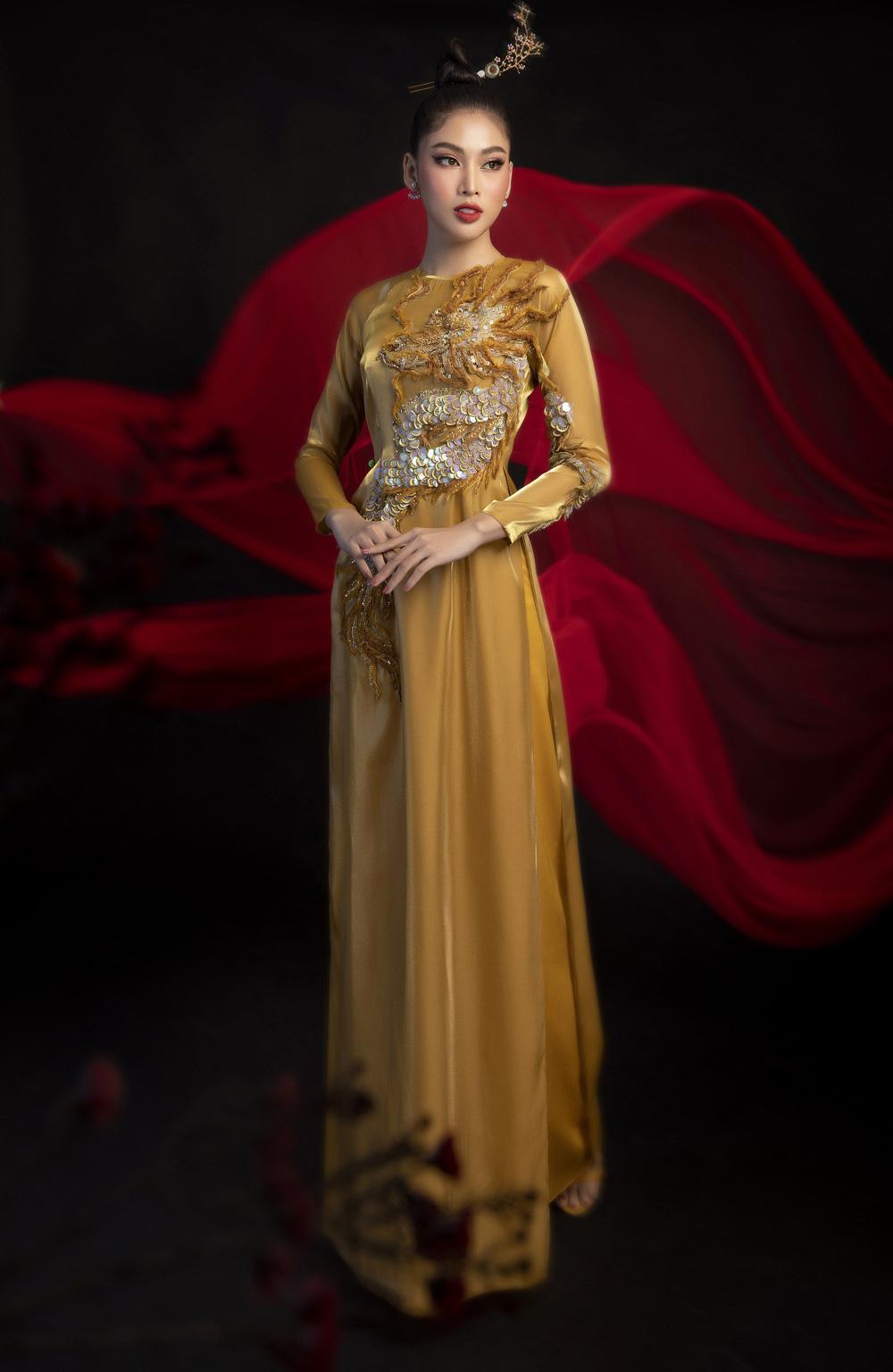 Hoa hậu Đỗ Thị Hà khoe vẻ sắc sảo với áo dài retro - ảnh 14