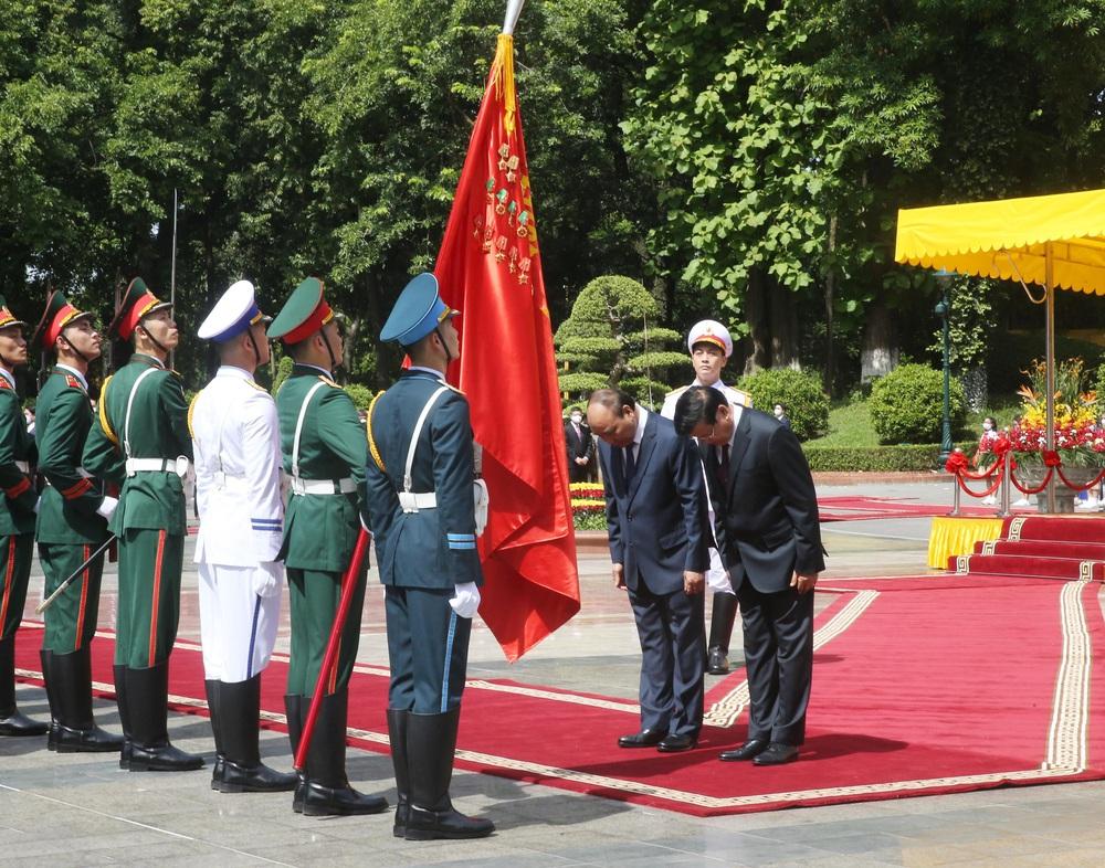 [ẢNH] Lễ đón Tổng Bí thư, Chủ tịch nước Lào Thongloun Sisoulith thăm hữu nghị chính thức Việt Nam - Ảnh 12.