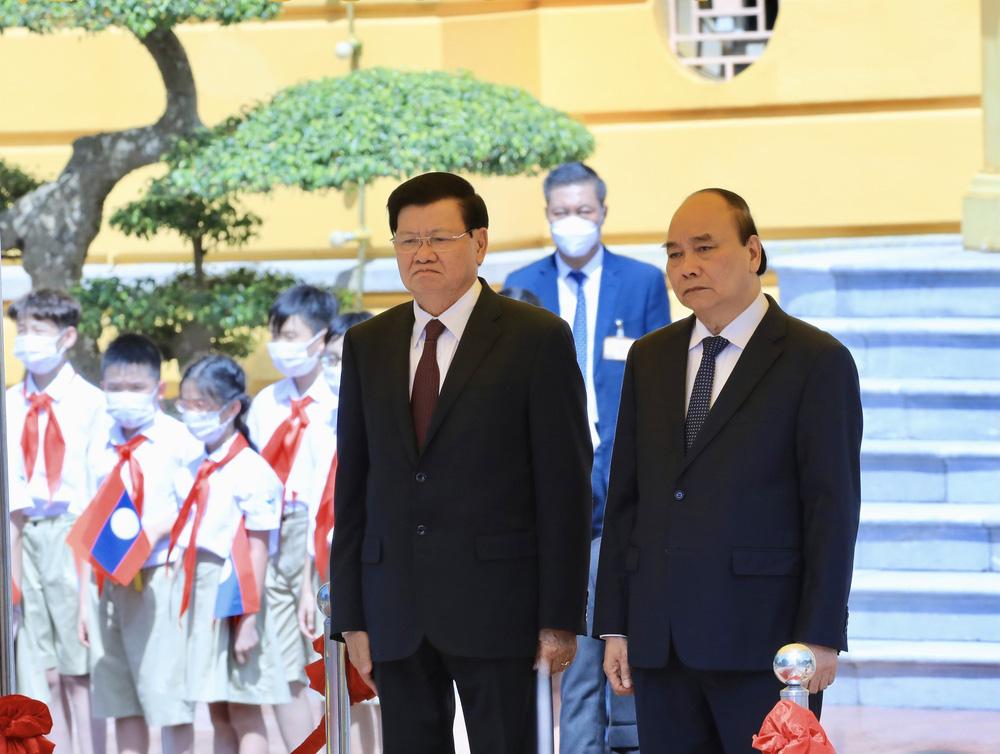[ẢNH] Lễ đón Tổng Bí thư, Chủ tịch nước Lào Thongloun Sisoulith thăm hữu nghị chính thức Việt Nam - Ảnh 13.