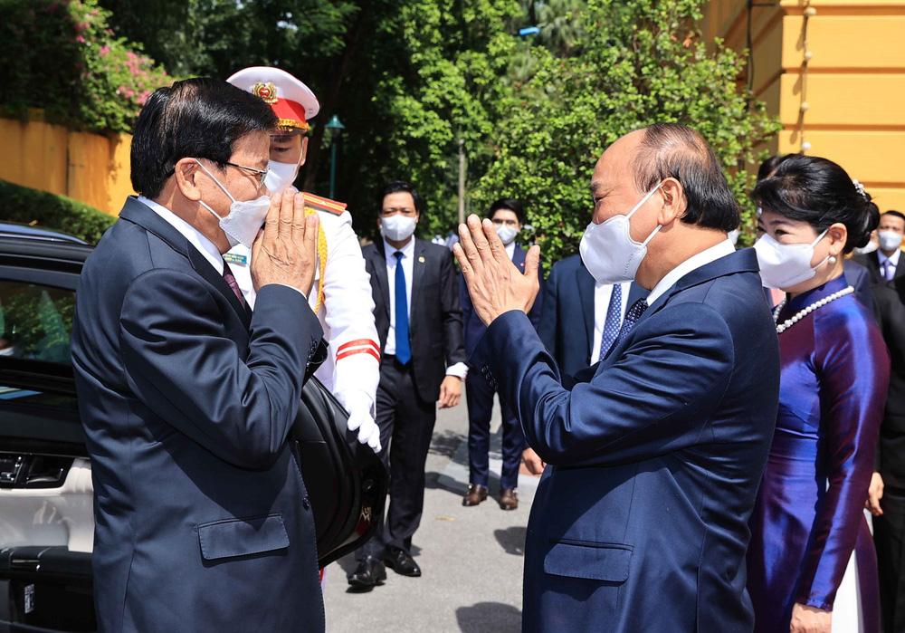 [ẢNH] Lễ đón Tổng Bí thư, Chủ tịch nước Lào Thongloun Sisoulith thăm hữu nghị chính thức Việt Nam - Ảnh 5.