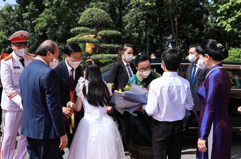 [ẢNH] Lễ đón Tổng Bí thư, Chủ tịch nước Lào Thongloun Sisoulith thăm hữu nghị chính thức Việt Nam - Ảnh 6.