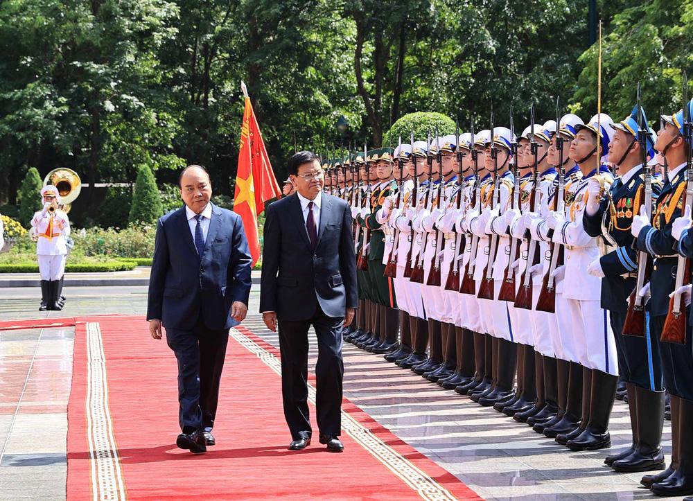[ẢNH] Lễ đón Tổng Bí thư, Chủ tịch nước Lào Thongloun Sisoulith thăm hữu nghị chính thức Việt Nam - Ảnh 11.