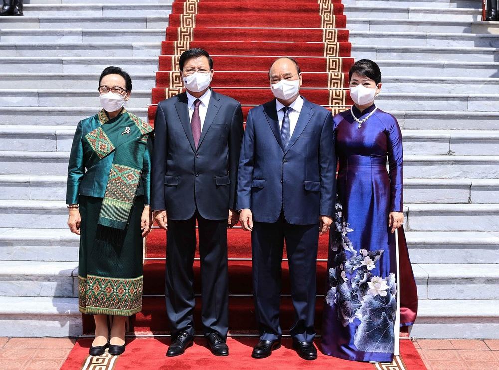 [ẢNH] Lễ đón Tổng Bí thư, Chủ tịch nước Lào Thongloun Sisoulith thăm hữu nghị chính thức Việt Nam - Ảnh 9.