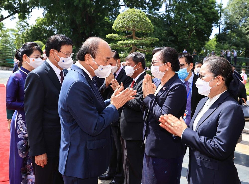 [ẢNH] Lễ đón Tổng Bí thư, Chủ tịch nước Lào Thongloun Sisoulith thăm hữu nghị chính thức Việt Nam - Ảnh 20.