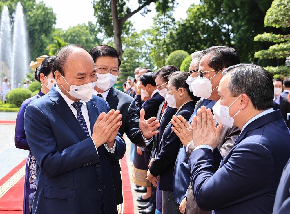 [ẢNH] Lễ đón Tổng Bí thư, Chủ tịch nước Lào Thongloun Sisoulith thăm hữu nghị chính thức Việt Nam - Ảnh 19.