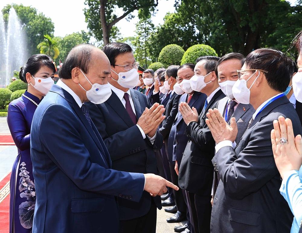 [ẢNH] Lễ đón Tổng Bí thư, Chủ tịch nước Lào Thongloun Sisoulith thăm hữu nghị chính thức Việt Nam - Ảnh 17.
