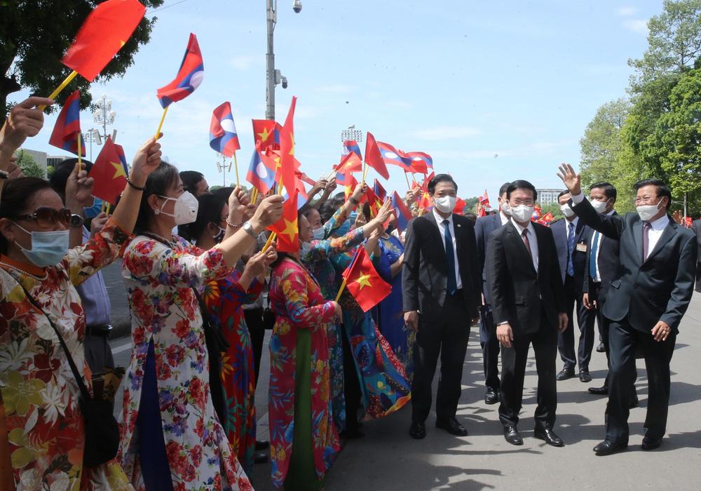 [ẢNH] Lễ đón Tổng Bí thư, Chủ tịch nước Lào Thongloun Sisoulith thăm hữu nghị chính thức Việt Nam - Ảnh 1.