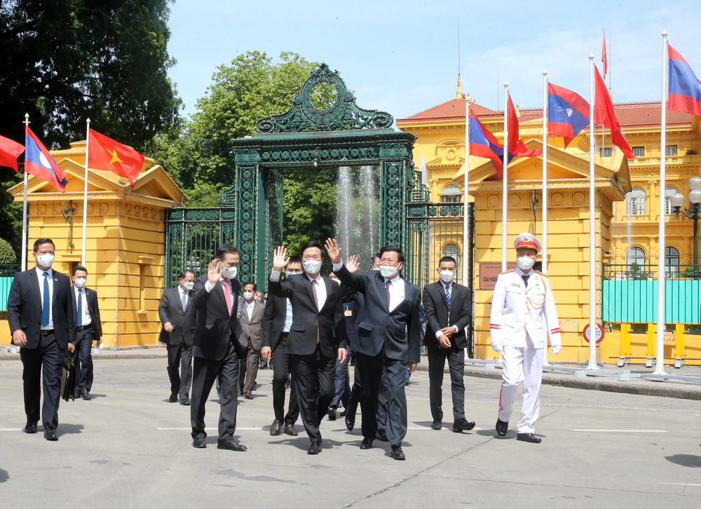 [ẢNH] Lễ đón Tổng Bí thư, Chủ tịch nước Lào Thongloun Sisoulith thăm hữu nghị chính thức Việt Nam - Ảnh 4.