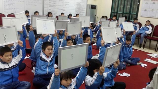 Nhà trường ủng hộ quy định không giao bài tập về nhà cho học sinh tiểu học - Ảnh 1.