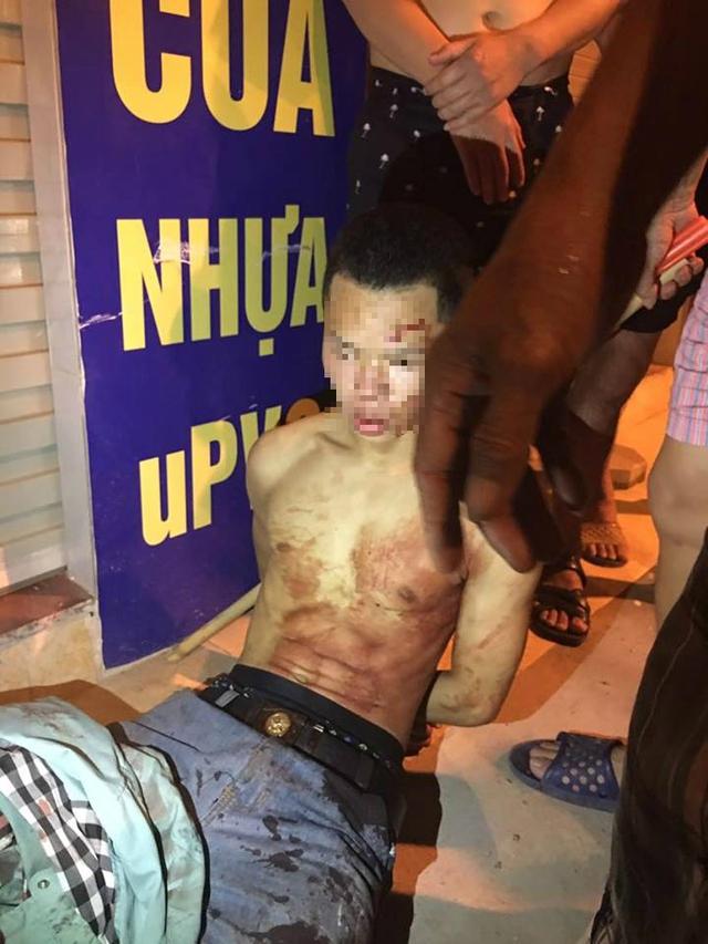 Hà Nội: Bắt tại trận tên cướp dùng dao cứa cổ tài xế taxi trong đêm - Ảnh 2.
