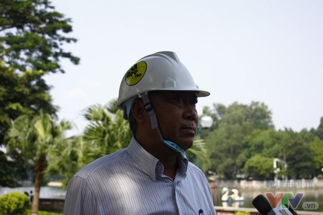 Dịch chuyển hàng cây xanh phố Kim Mã để xây đường sắt Nhổn – ga Hà Nội - Ảnh 2.