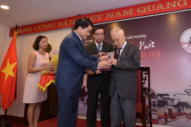 Chân dung nhiếp ảnh gia giành giải thưởng lớn Vì tình yêu Hà Nội - Ảnh 1.
