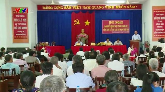 Tiếp xúc cử tri tại Long An, Trà Vinh sau kỳ họp Quốc hội - Ảnh 1.