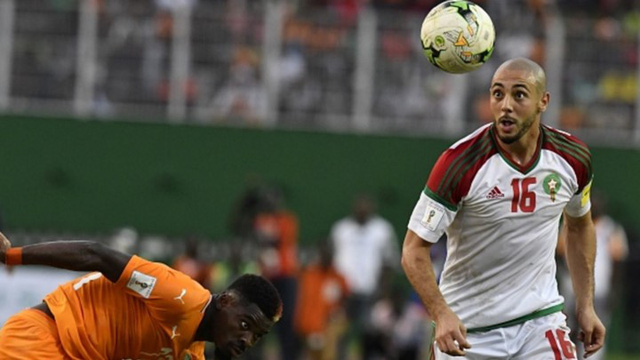 [CHÙM ẢNH] Người dân Maroc tràn xuống đường ăn mừng vé dự World Cup 2018 - Ảnh 1.