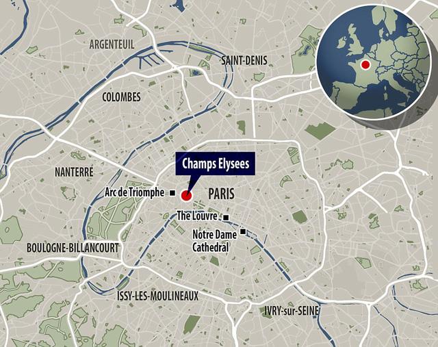 Hiện trường vụ tấn công ngay tại Đại lộ Champs-Elysees làm một cảnh sát thiệt mạng - Ảnh 4.