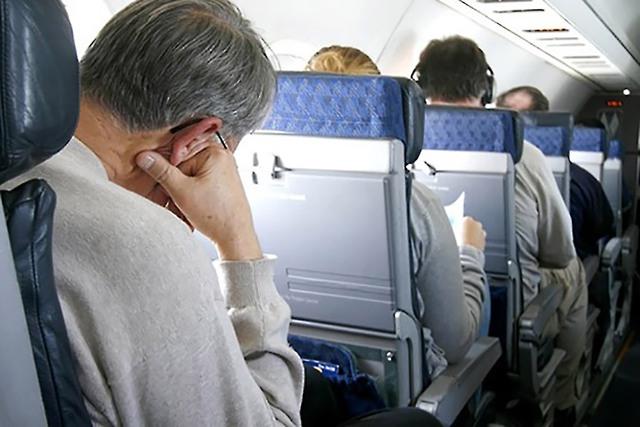Những kiểu người ai cũng hết hồn trên mỗi chuyến bay - Ảnh 4.
