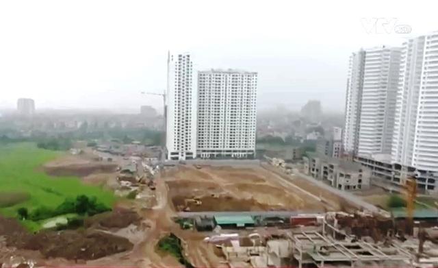 Nhiều dự án chung cư mắc kẹt do không có đường vào - Ảnh 1.