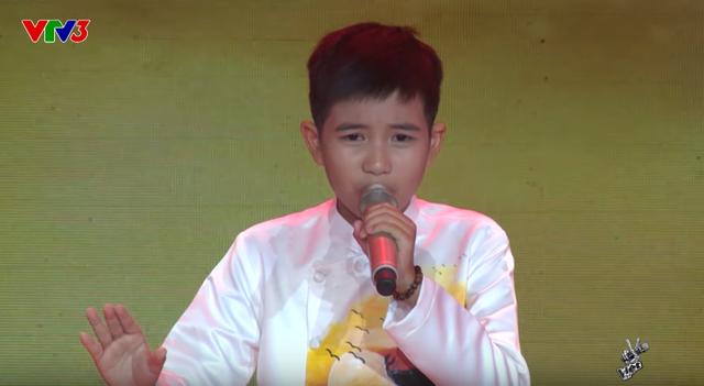 Giọng hát Việt nhí: Học trò ma mị của Vũ Cát Tường gây tranh luận trên ghế nóng - Ảnh 1.