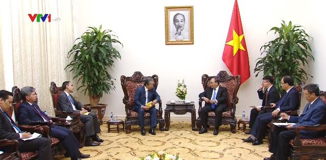 Chính phủ tiếp tục tháo gỡ khó khăn cho DN Malaysia vào Việt Nam - Ảnh 1.